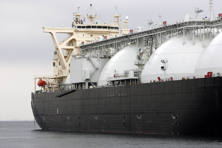 A liquefied natural gas (LNG) tanker operated by Energy Advance Co., a unit of Tokyo Gas Co., is moored at the company's Sodegaura plant in Sodegaura City, Chiba Prefecture, Japan, on Thursday, March 22, 2012. Photographer: Tomohiro Ohsumi/Bloomberg
