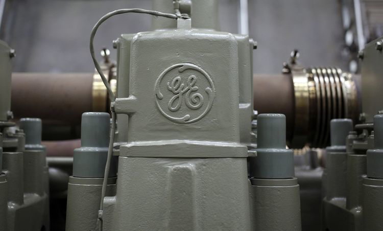A General Electric Co. (GE) logo is seen on a twelve cylinder diesel engine for an Evolution Series Tier 4 diesel locomotive at the GE Manufacturing Solutions facility in Fort Worth, Texas, U.S. Photographer: Luke Sharrett/Bloomberg