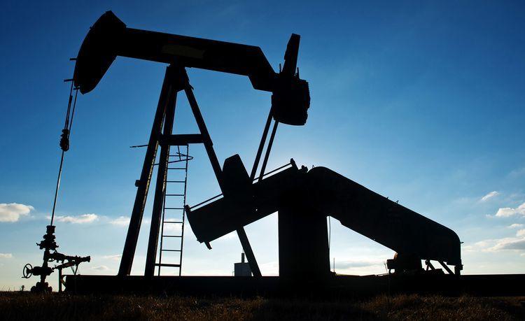 A pump jack operates in an oil field near Corpus Christi, Texas. Photographer: Eddie Seal/Bloomberg
