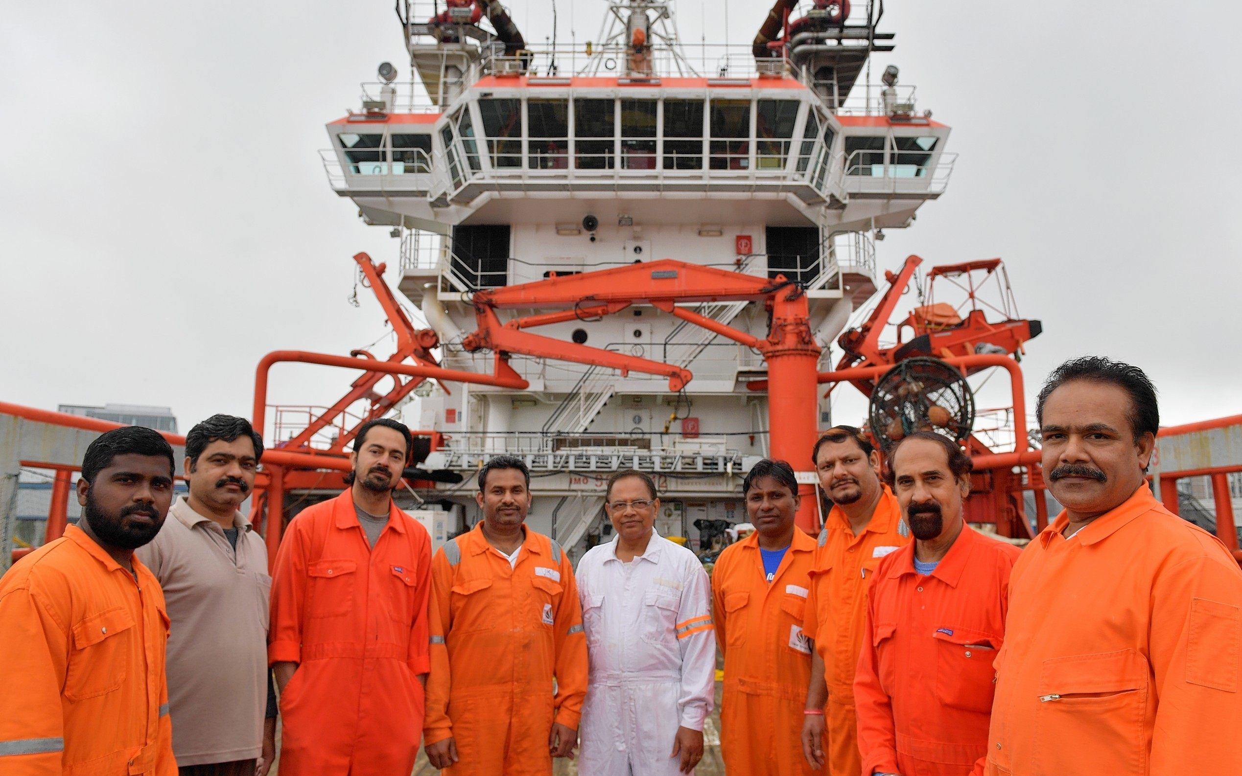 The crew of the Indian owned Malaviya Seven offshore vessel which has been detained in Aberdeen since last year for non payment of wages, are waiting on a court hearing which could decide if they can go home.    Pictured - Some of the twelve man crew on the vessel.