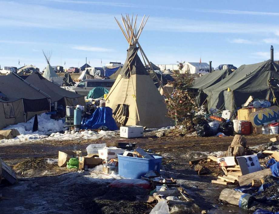 Debris is piled on the ground awaiting pickup by cleanup crews at the Dakota Access oil pipeline protest camp in southern North Dakota near Cannon Ball. The camp is on federal land, and authorities have told occupants to leave by Wednesday, Feb. 22 in advance of spring flooding.