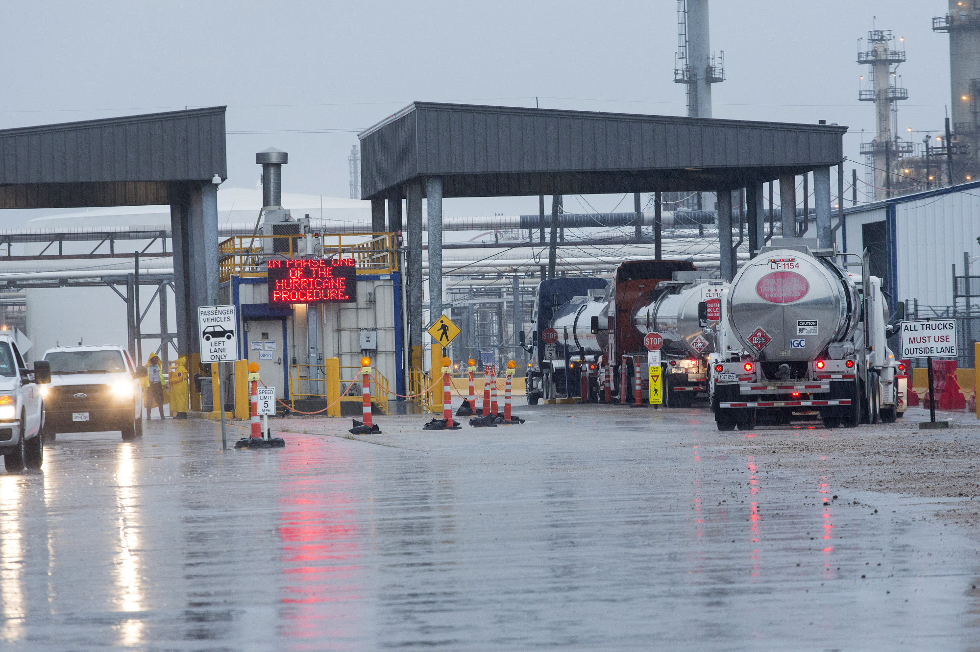 Tanker trucks enter a refinery ahead of Hurricane Harvey in Texas City, on Aug. 25.