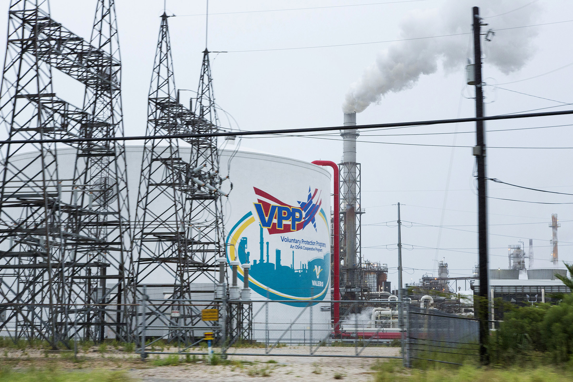 The Valero Energy Corp. refinery stands ahead of Hurricane Harvey in Texas City, Texas, U.S., on Friday, Aug. 25, 2017. Hurricane Harveystrengthened as it headed toward landfall in Texas, forecast to become the worst storm to strike the region in more than a decade. The price of gasolineralliedas it threatened to wreak havoc on the heart of America's energy sector. Photographer: F. Carter Smith/Bloomberg