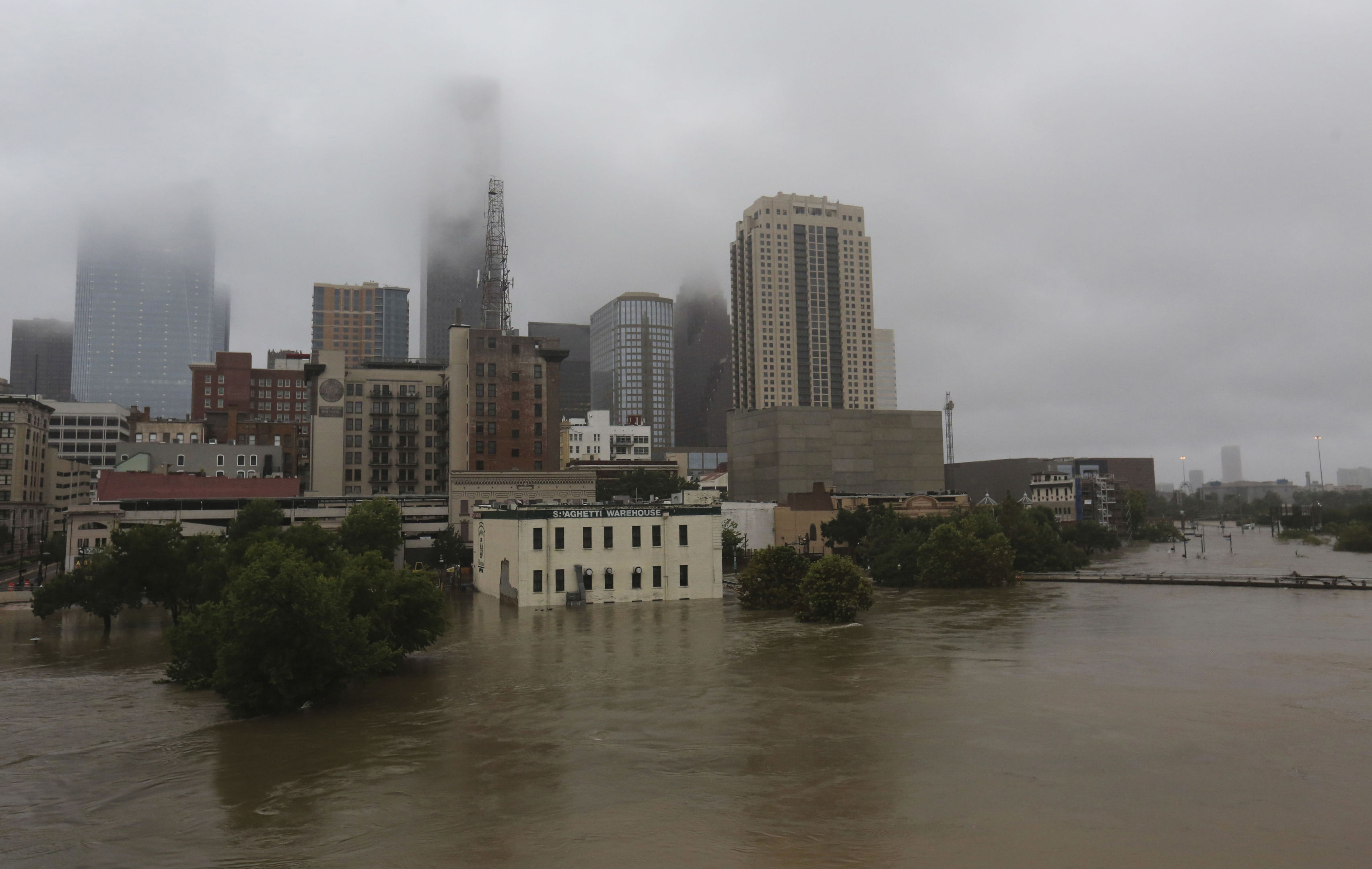 Floodwaters from Tropical Storm Harvey flow in the Buffalo Bayou in downtown Houston, Texas