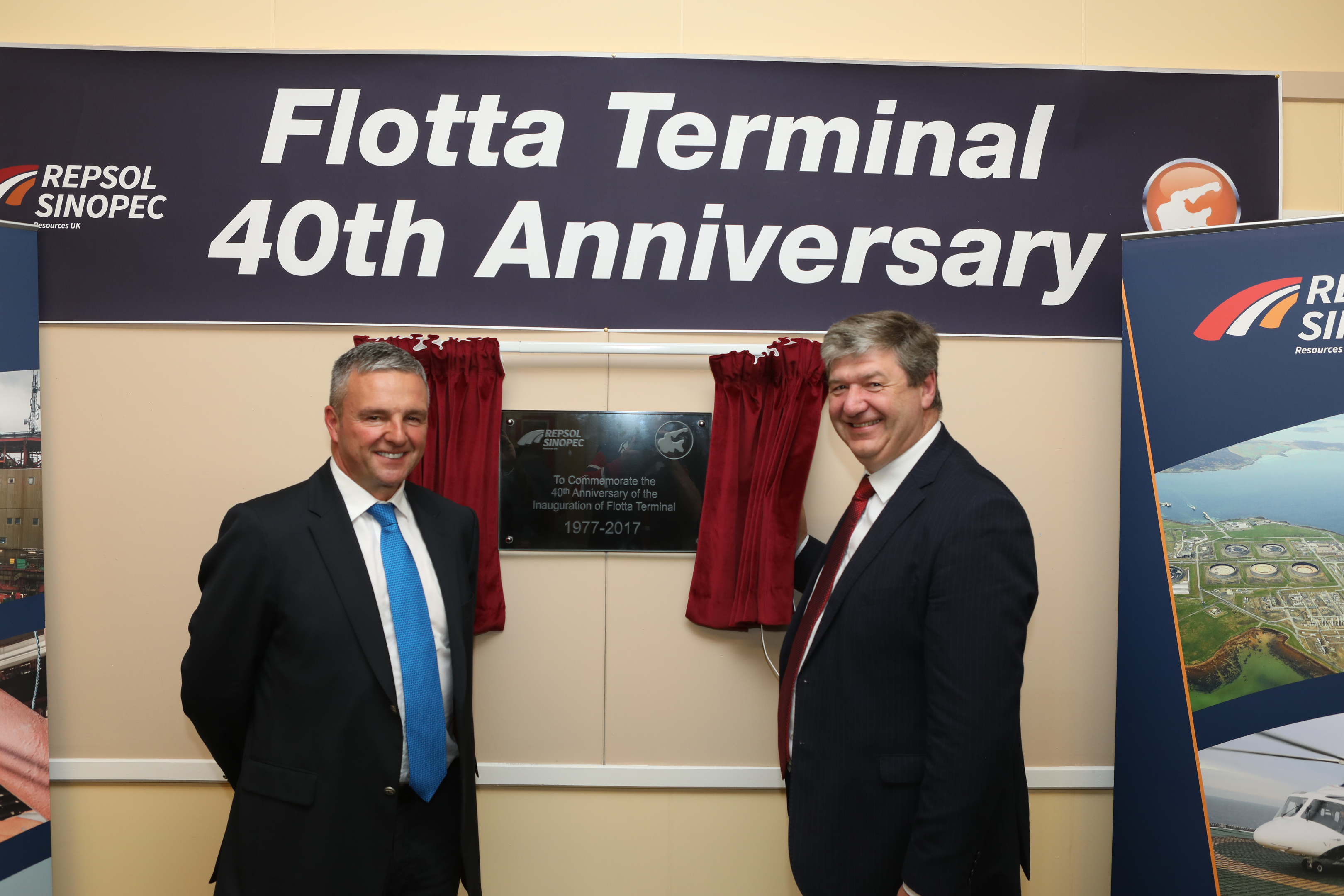 RSRUK managing director Bill Dunnett, right, and MP for Orkney and Shetland Alistair Carmichael unveil the plaque celebrating the Flotta terminal's 40th birthday.