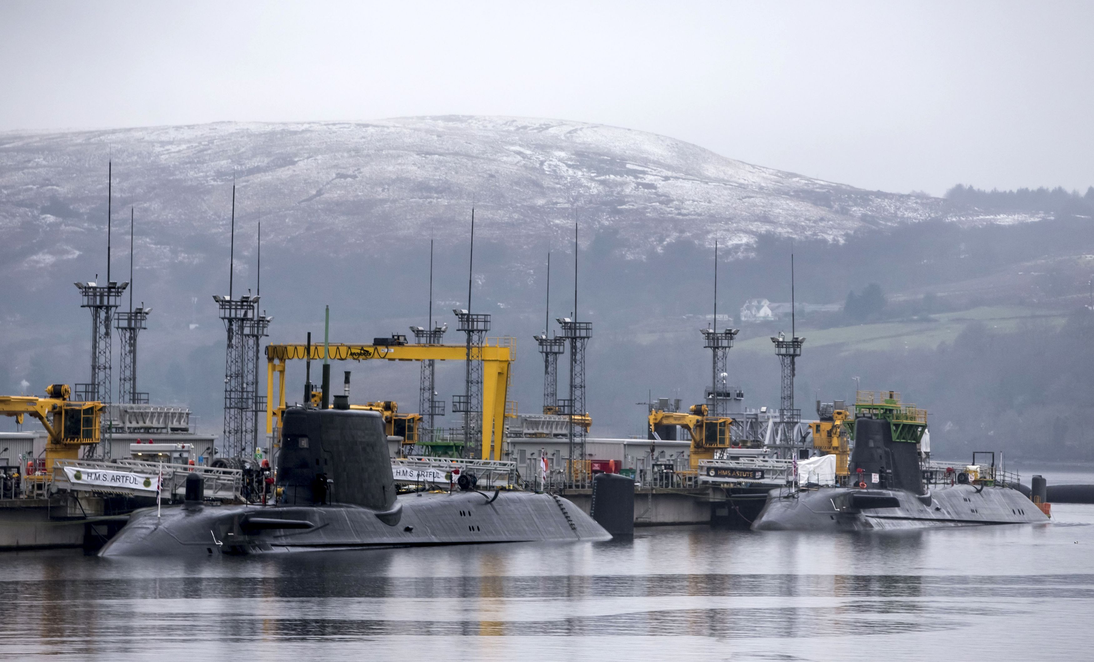 Astute-class submarines HMS Artful (left) and HMS Astute (right), at HM Naval Base Clyde, also known as Faslane, ahead of a visit by Defence Secretary Michael Fallon.