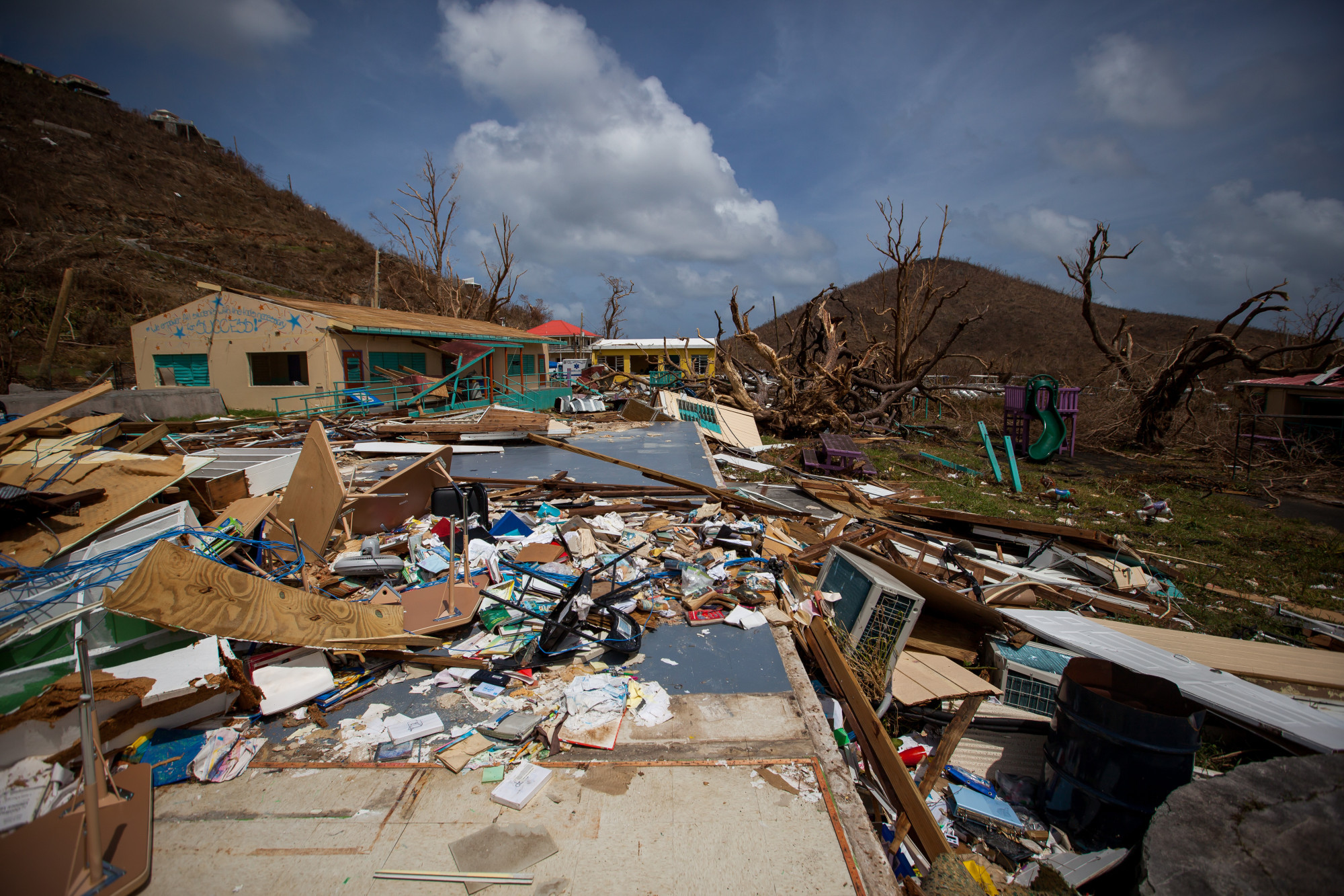 Debris sits in front of a damaged school after Hurricane Irma at Coral Bay in St John, U.S. Virgin Islands. Photographer: Michael Nagle/Bloomberg