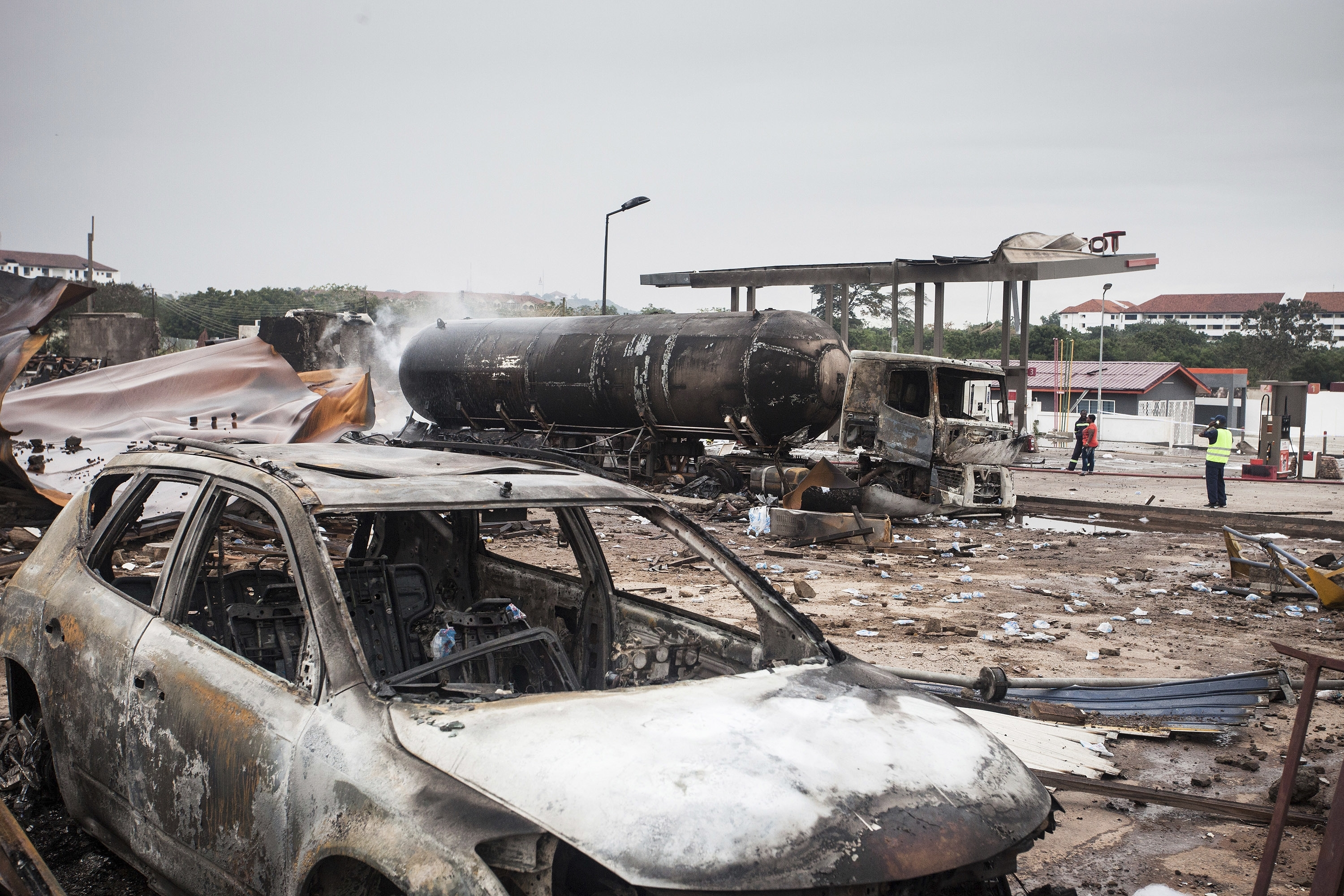 Firemen at the site of Saturday's gas tanker explosion in Accra, Ghana. Sunday Oct. 8, 2017.