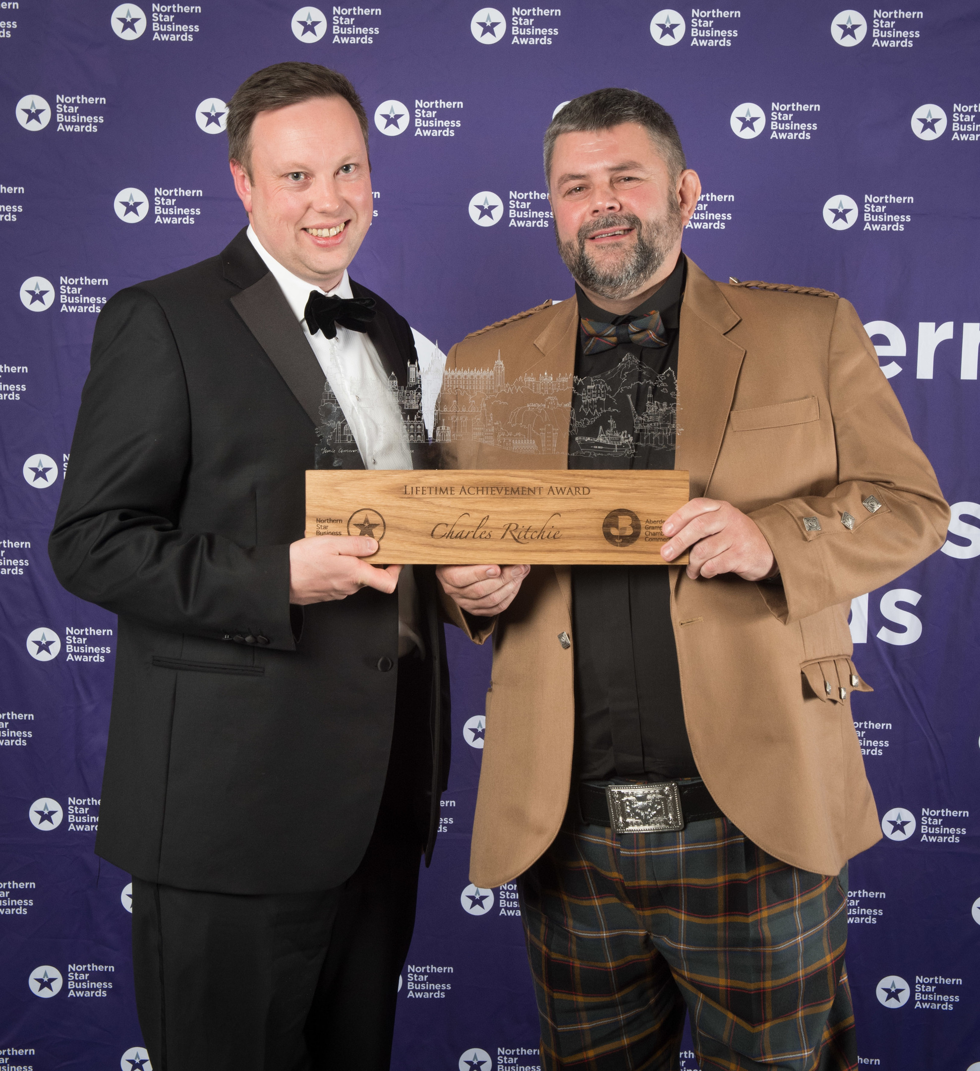 Conrad Ritchie, right, accepts the lifetime achievement award on behalf of his late father, Charles, with awards sponsor Fraser Carr from Cala Homes  Picture by Michal Wachucik / Abermedia