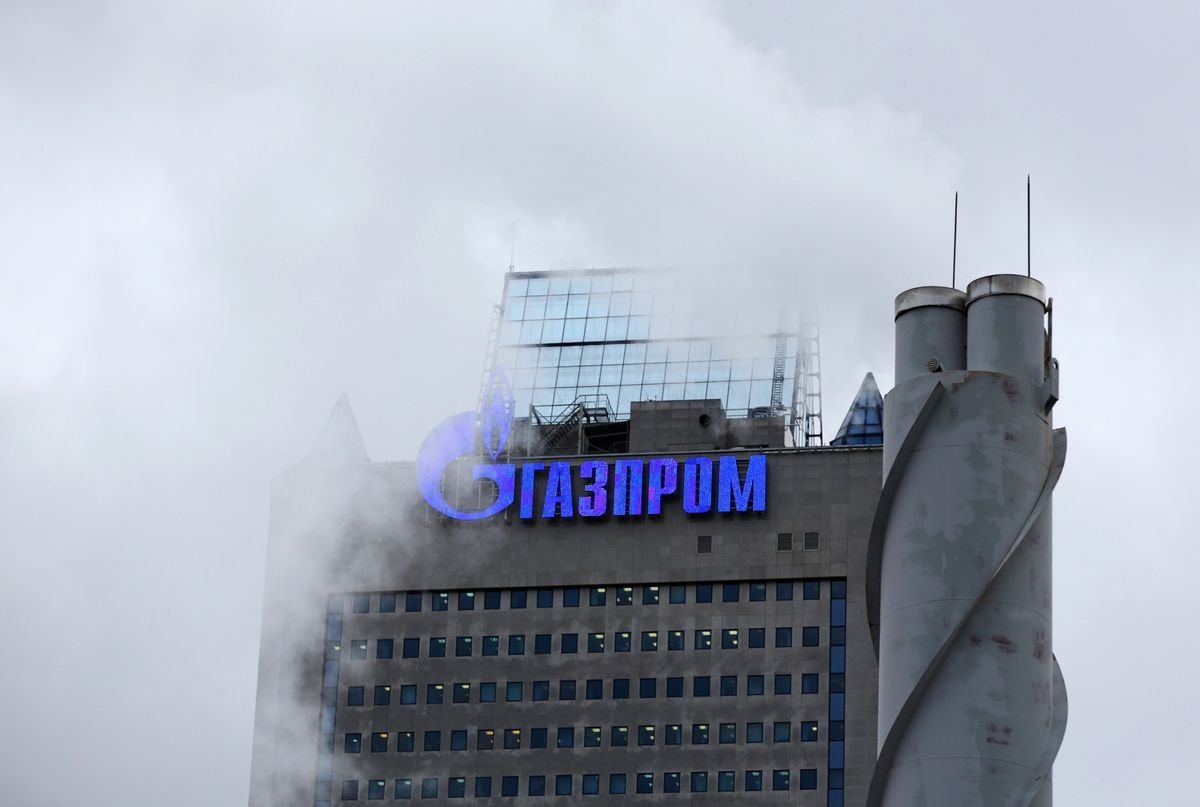 A logo sits on display outside the headquarters of OAO Gazprom in Moscow, Russia. Photographer: Andrey Rudakov/Bloomberg