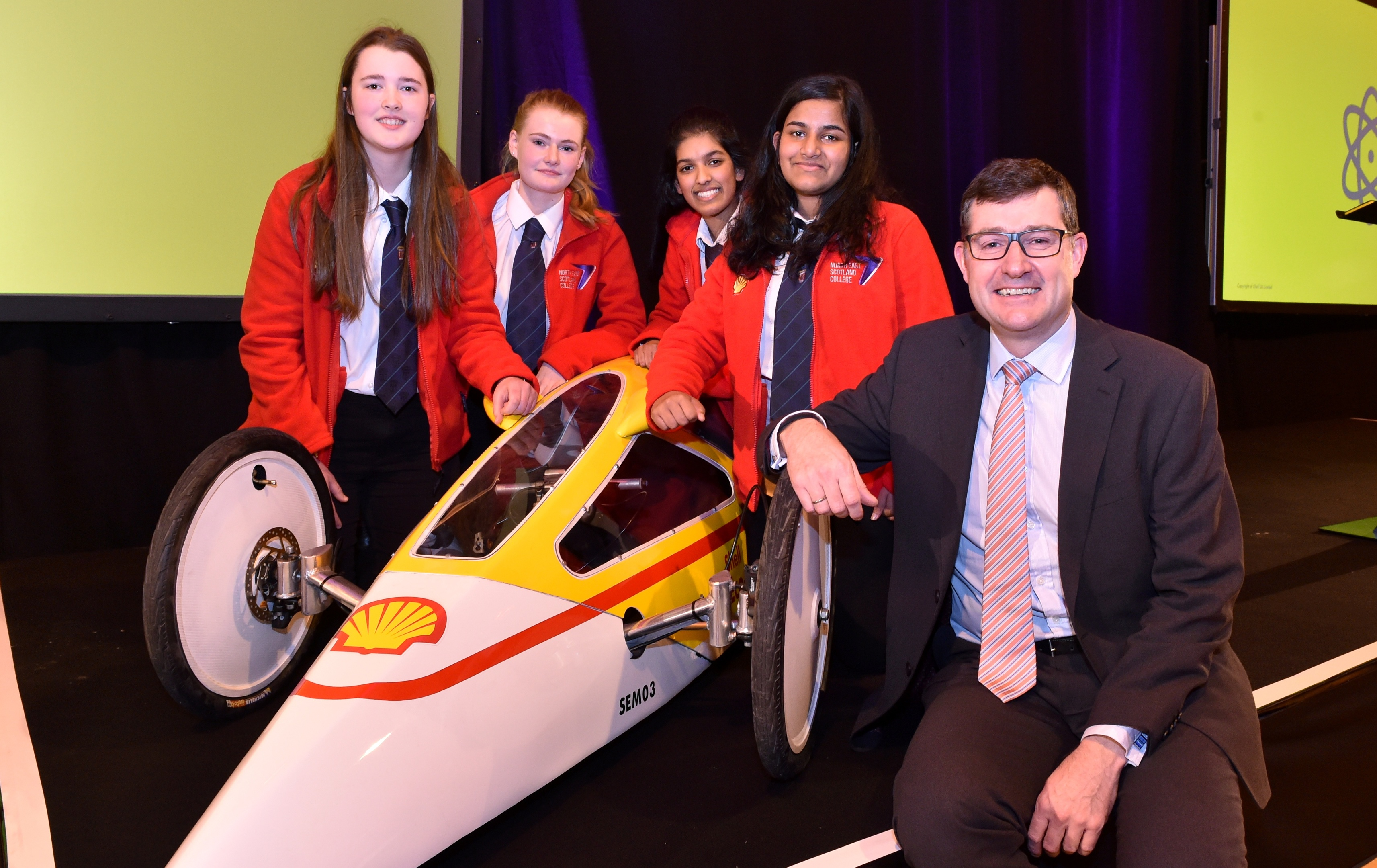 Shell - Woodbank House, North Deeside Road - Shell's annual Girls in Energy event. Winners - Hazlehead (from left) Kirsty Hyslop 16, Lillian Kelly 16, Nova Paulose 16 and Kessia Thomas 16 with Shell's Steve Phimister, Upstream Vice President for UK and Ireland. Picture by COLIN RENNIE  December 1, 2017.