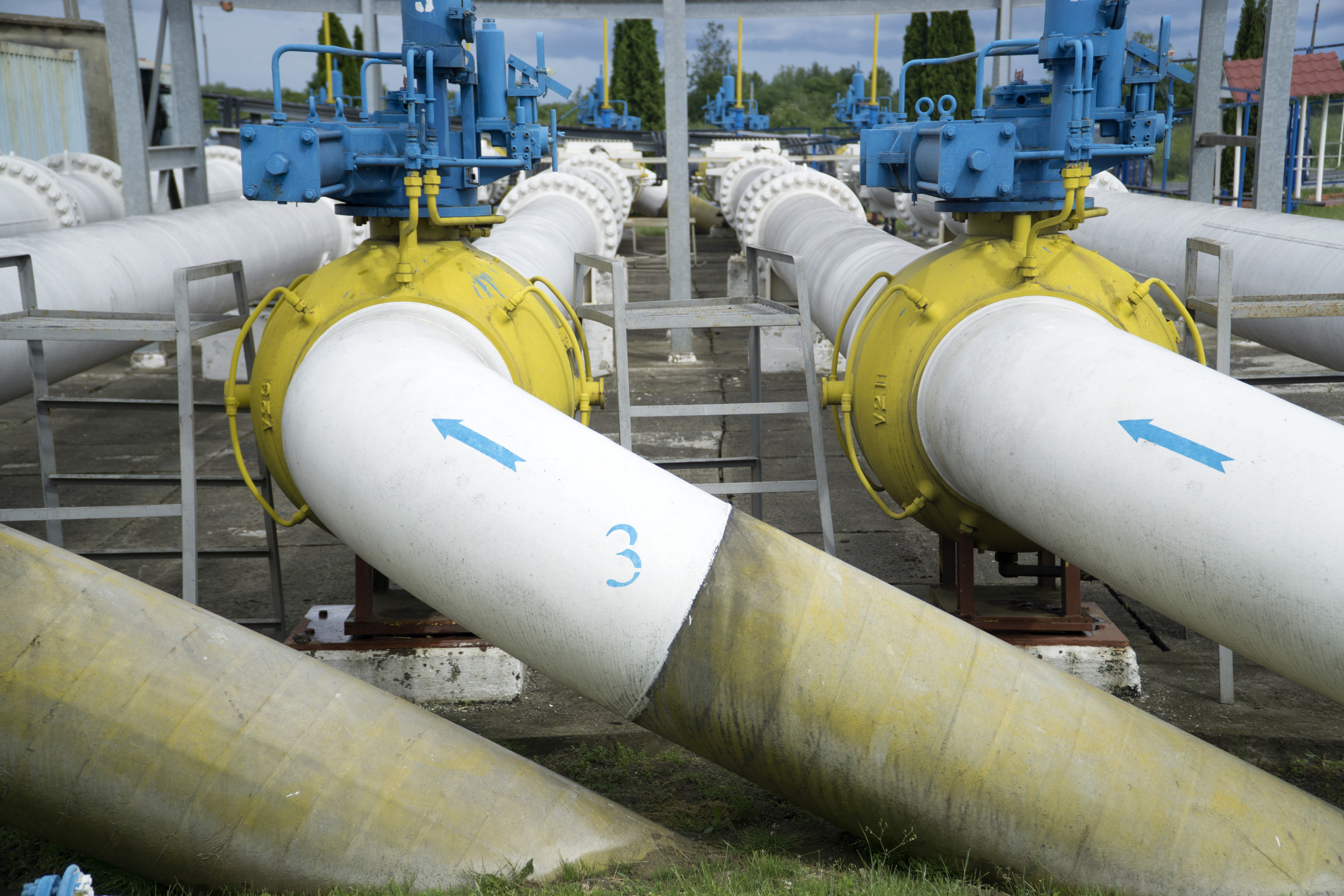 Flow direction arrows sit on trunk pipes at the gas metering station, operated by NAK Naftogaz Ukrainy, in Uzhgorod, Ukraine. Photographer: Vincent Mundy/Bloomberg