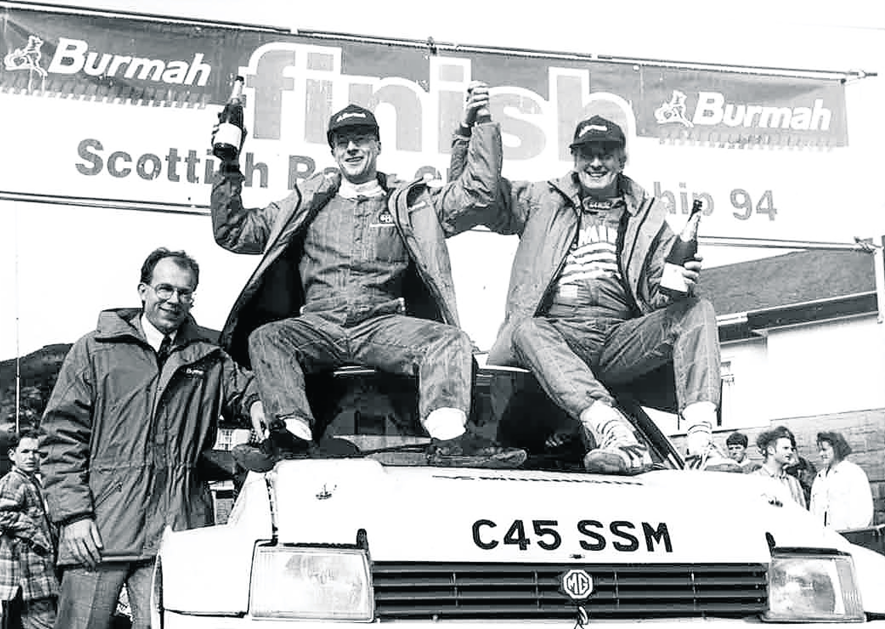 Donald Milne, middle, and Bob Wilson celebrate winning the championship with Richard Miles, of Burmah Petroleum, looking on