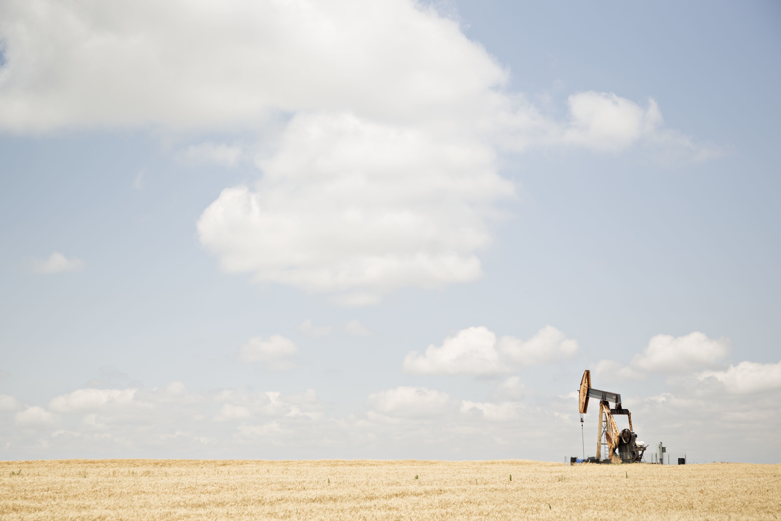 A pumpjack operates in the Bemis-Shutts oil field near Hays, Kansas, U.S., on Thursday, June 29, 2017. Photographer: Daniel Acker/Bloomberg