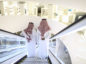 Attendees stand on an escalator as they move through the interior of the King Abdulaziz Center for World Culture during a tour of the project in Dhahran, Saudi Arabia, on Friday, Nov. 25, 2016. When completed, the project designed for the Saudi Arabian Oil Co. (Aramco) will contain diverse cultural facilities, including an auditorium, cinema, library, exhibition hall, museum and archive. Photographer: Simon Dawson/Bloomberg