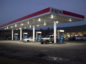 Customers fuel vehicles at an Exxon Mobil Corp. gas station in Nashport, Ohio, U.S., on Friday, Jan. 26, 2018. Photographer: Ty Wright/Bloomberg