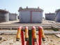 Outlet pipes and fuel storage tanks are seen at the Zawiya oil refinery near Tripoli, Libya, on Monday, Aug. 29, 2011.  Photographer: Shawn Baldwin/Bloomberg