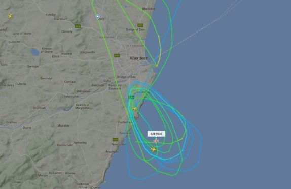 The plane was forced to circle overhead.