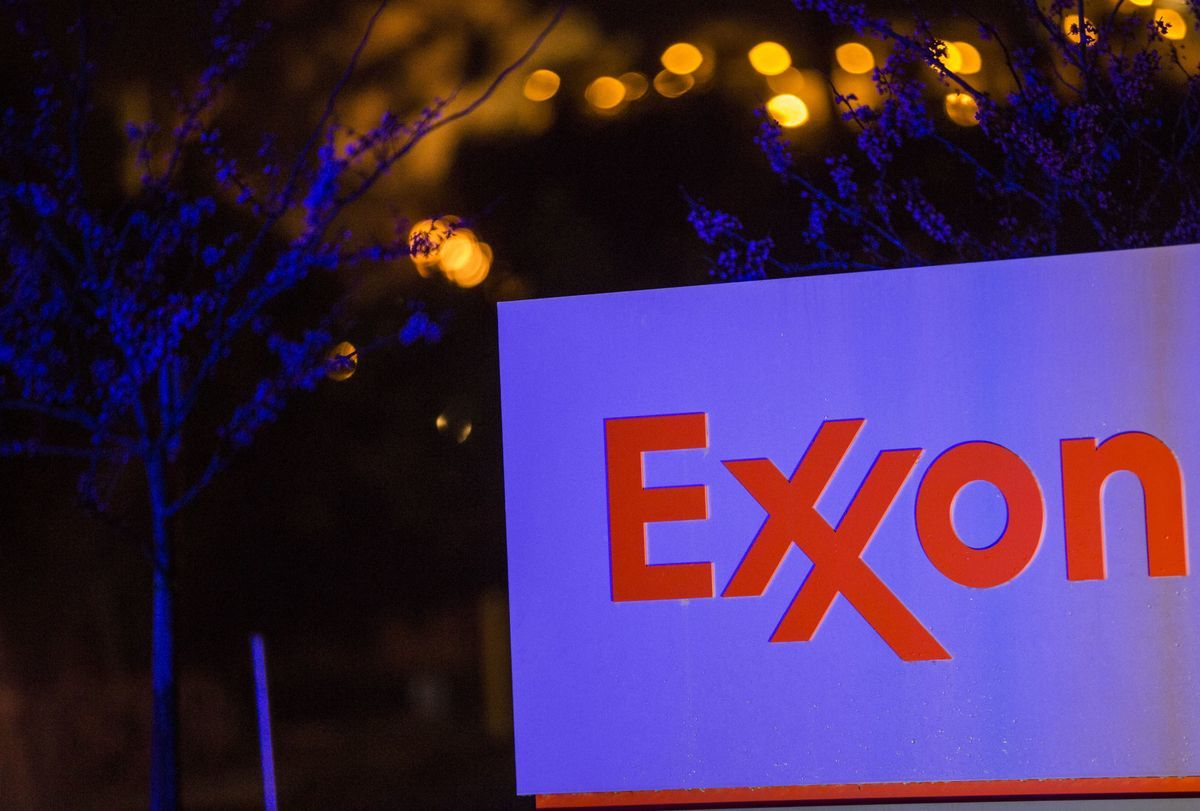 Lights from a police car are reflected on Exxon Mobil Corp. signage displayed at the company's Torrance Refinery in Torrance, California, U.S. Photographer:Patrick T. Fallon/ Bloomberg