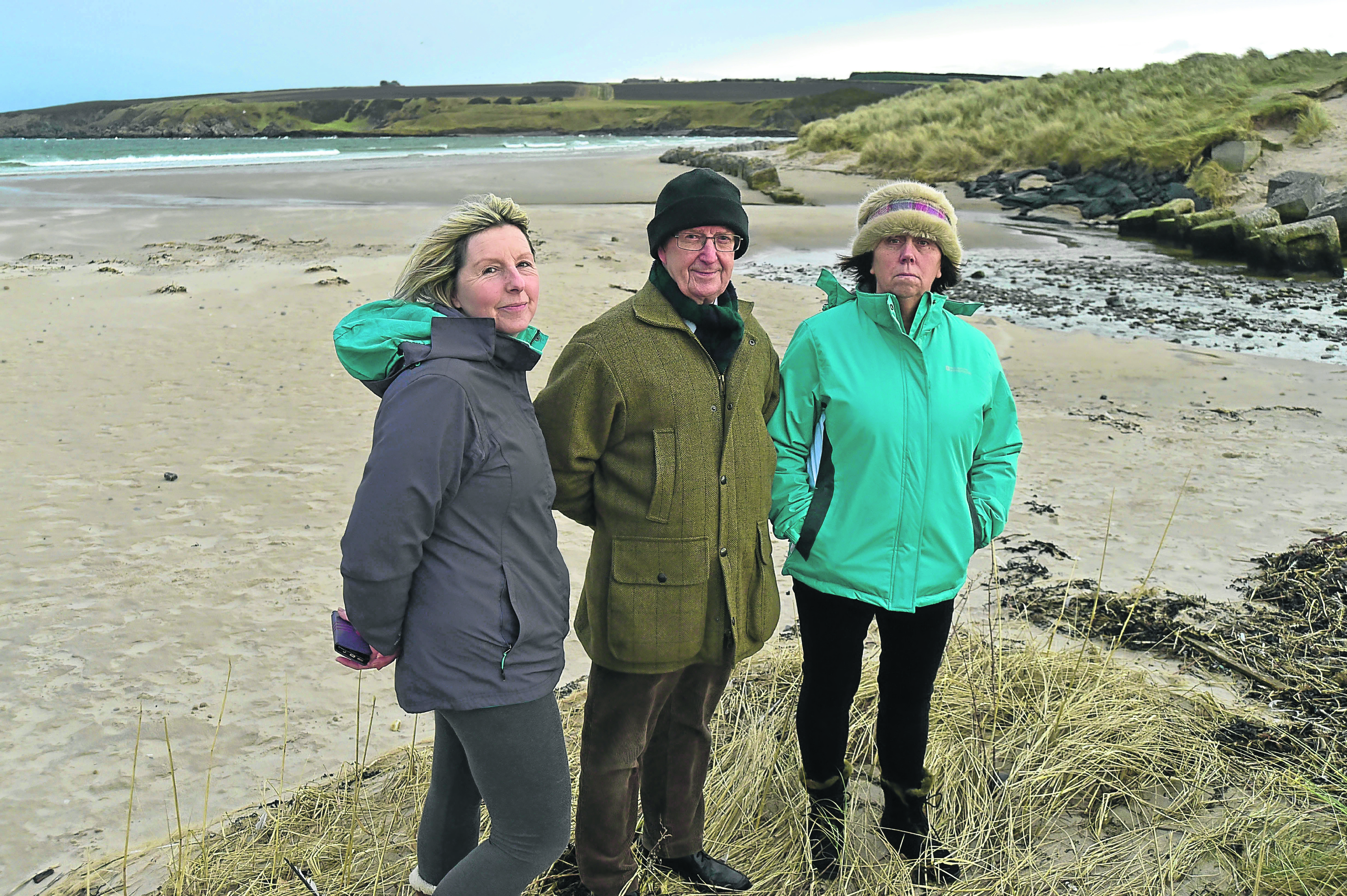 Sandend residents, from left, Tina Wilson, Ray Murray and Jane Winfield look over the area where the cables could come in