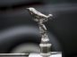 A 'Flying Lady' hood ornament sits on a 1914 Rolls-Royce Silver Ghost motor vehicle, manufactured by Rolls-Royce Motor Cars Ltd., during the 2016 Pebble Beach Concours d'Elegance in Pebble Beach, California, U.S., on Sunday, Aug. 21, 2016. Photographer: David Paul Morris