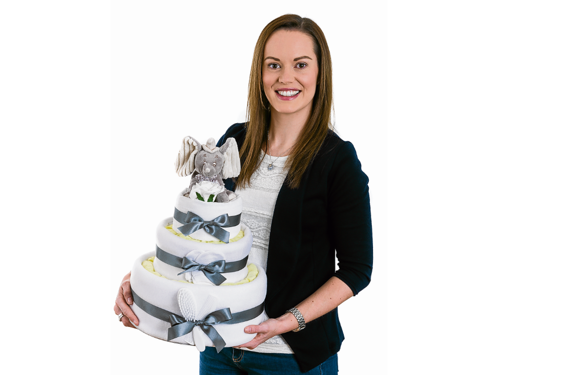 Fiona Welsh with one of her novelty gift cakes inspired by nappies