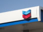 The Chevron Corp. logo is displayed at a gas station in Dallas, Texas, U.S., on Wednesday, July. 26, 2017. Chevron Corp. is scheduled to release earnings figures on July 28. Photographer: Cooper Neill/Bloomberg