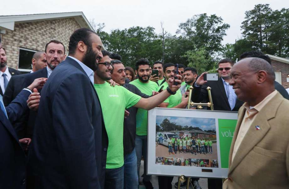 His Royal Highness Crown Prince Mohammed bin Salman smiles at volunteers at a Habitat for Humanity home Saturday, April 7, 2018, in Houston. His Royal Highness Crown Prince Mohammed bin Salman visited a habitat for humanity home that aided Harvey victims and was supported by donations by the Aramco, the Saudi oil company. ( Steve Gonzales / Houston Chronicle )