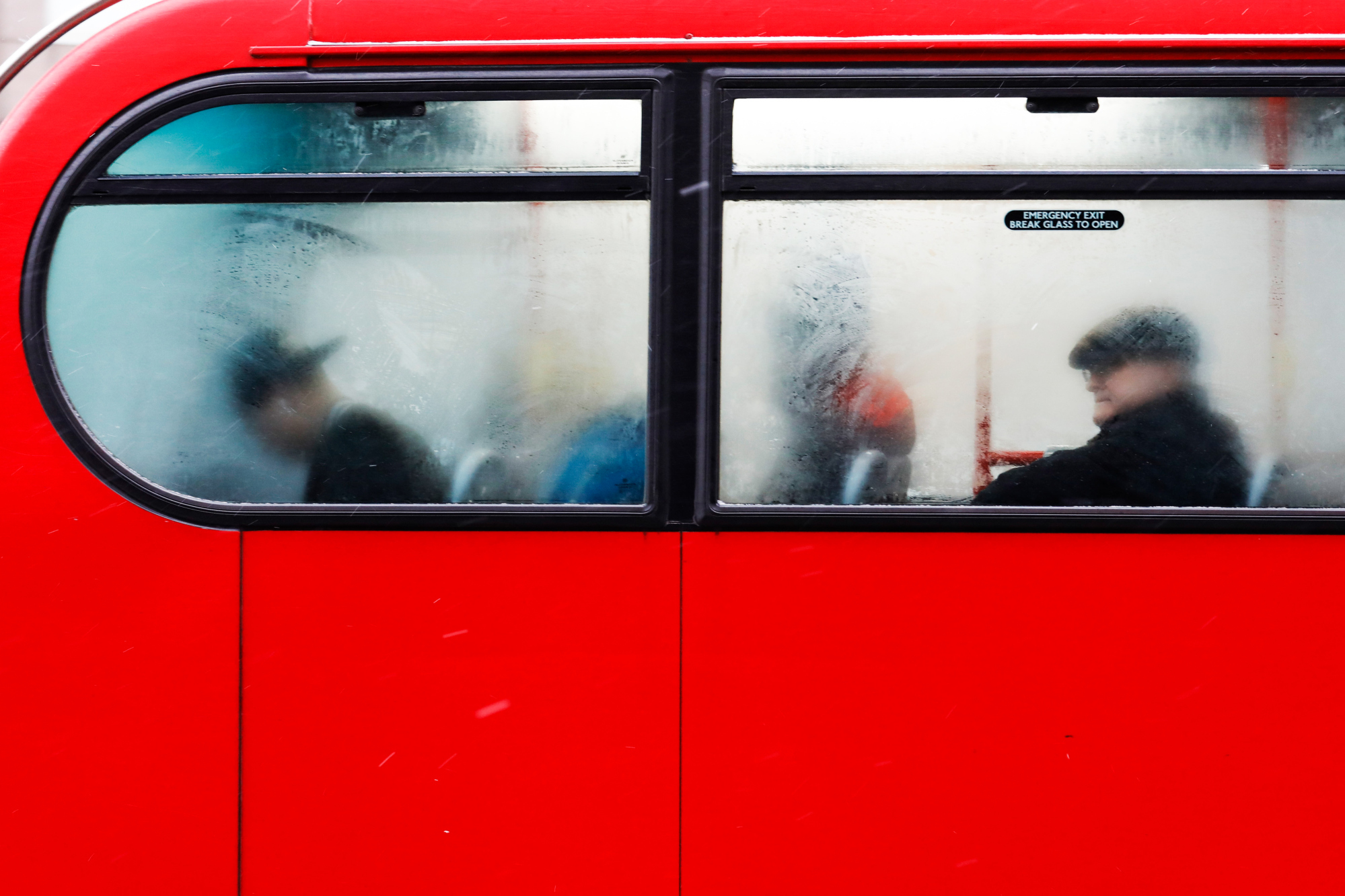 Commuters ride on a bus in London, U.K., on Thursday, March 1, 2018. The freezing weather entrenched across much of Europe is stretching Britain's supply of natural gas with fresh snowfall forecast for much of the country. Photographer: Luke MacGregor/Bloomberg