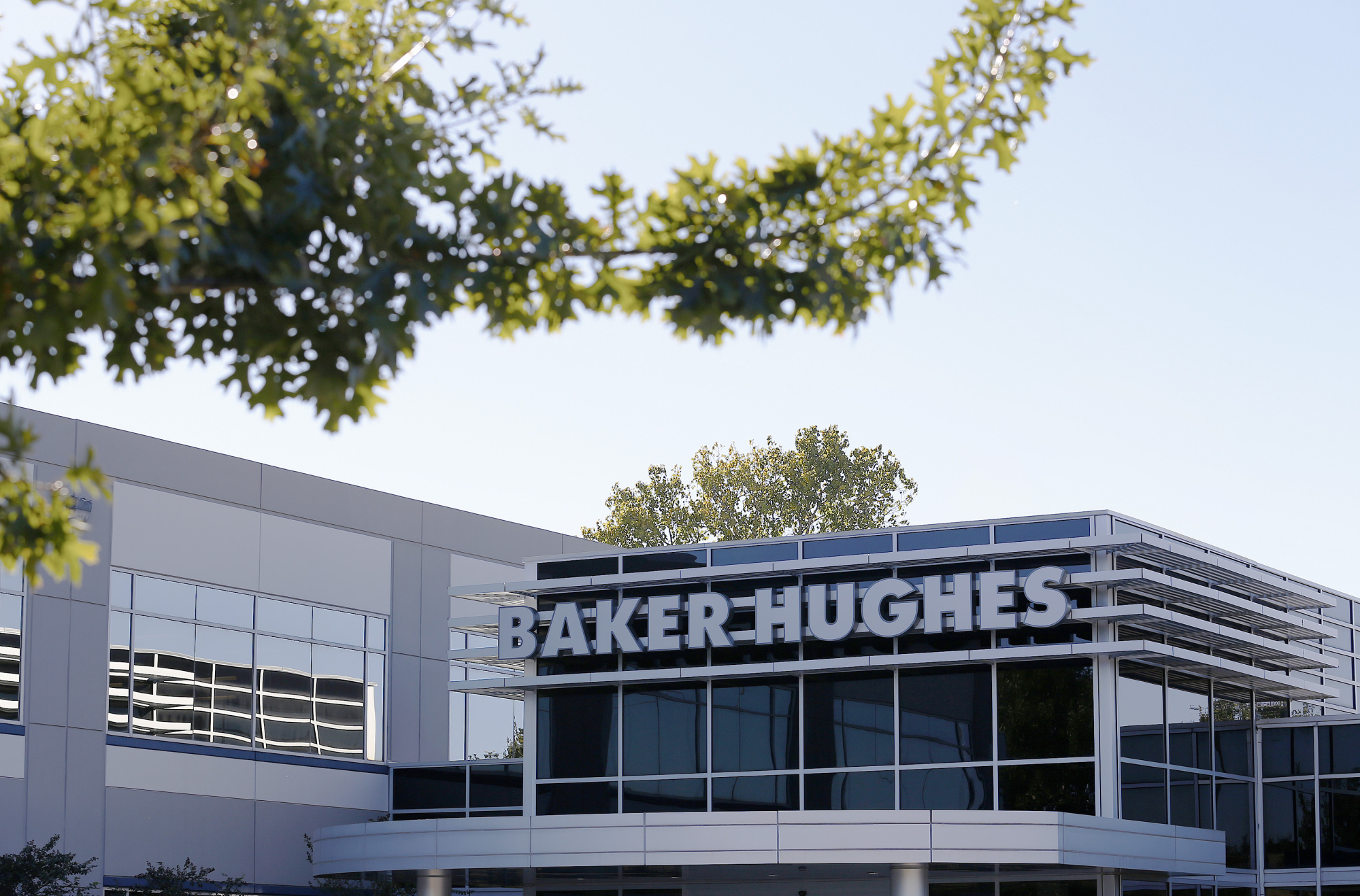 Baker Hughes Inc. signage is displayed at one of the company's facilities in Houston, Texas, U.S. Photographer: Aaron M. Sprecher/Bloomberg