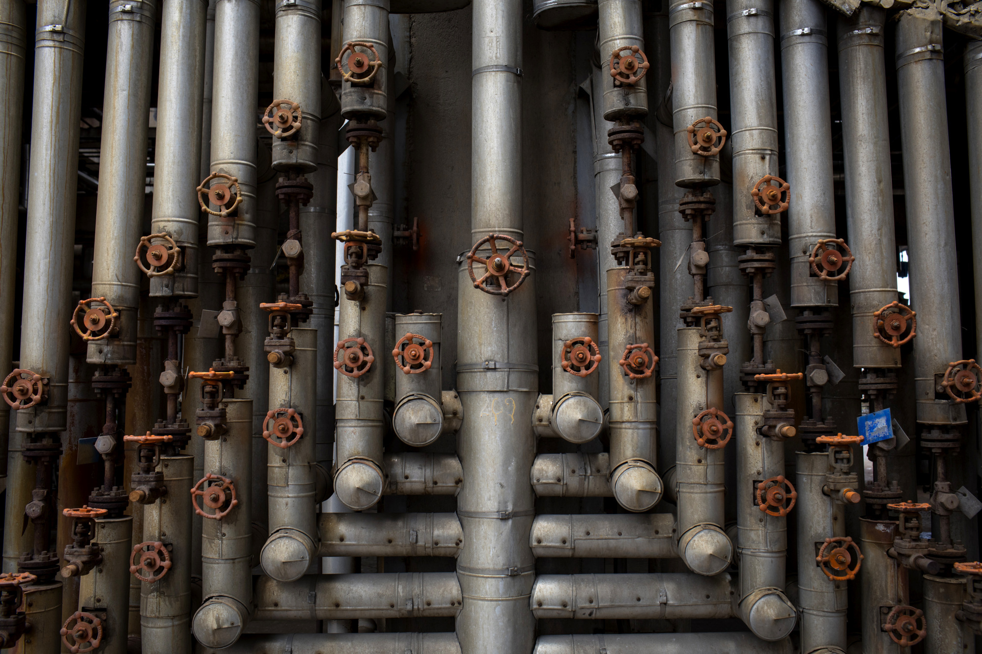 Pipes stand at a cracking plant for the Ecopetrol SA refinery in Barrancabermeja, Santander, Colombia, on Friday, April 20, 2018. Colombia's state-run oil company contained a spill in late March after more than 20 days and approximately 550 barrels of crude oil flowed into water sources in the Santander province. Photographer: Nicolo Filippo Rosso/Bloomberg
