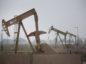 Electric oil pump jacks stand in the oil fields surrounding Midland, Texas, U.S., on Wednesday, Nov. 8, 2017. Photographer: Luke Sharrett/Bloomberg
