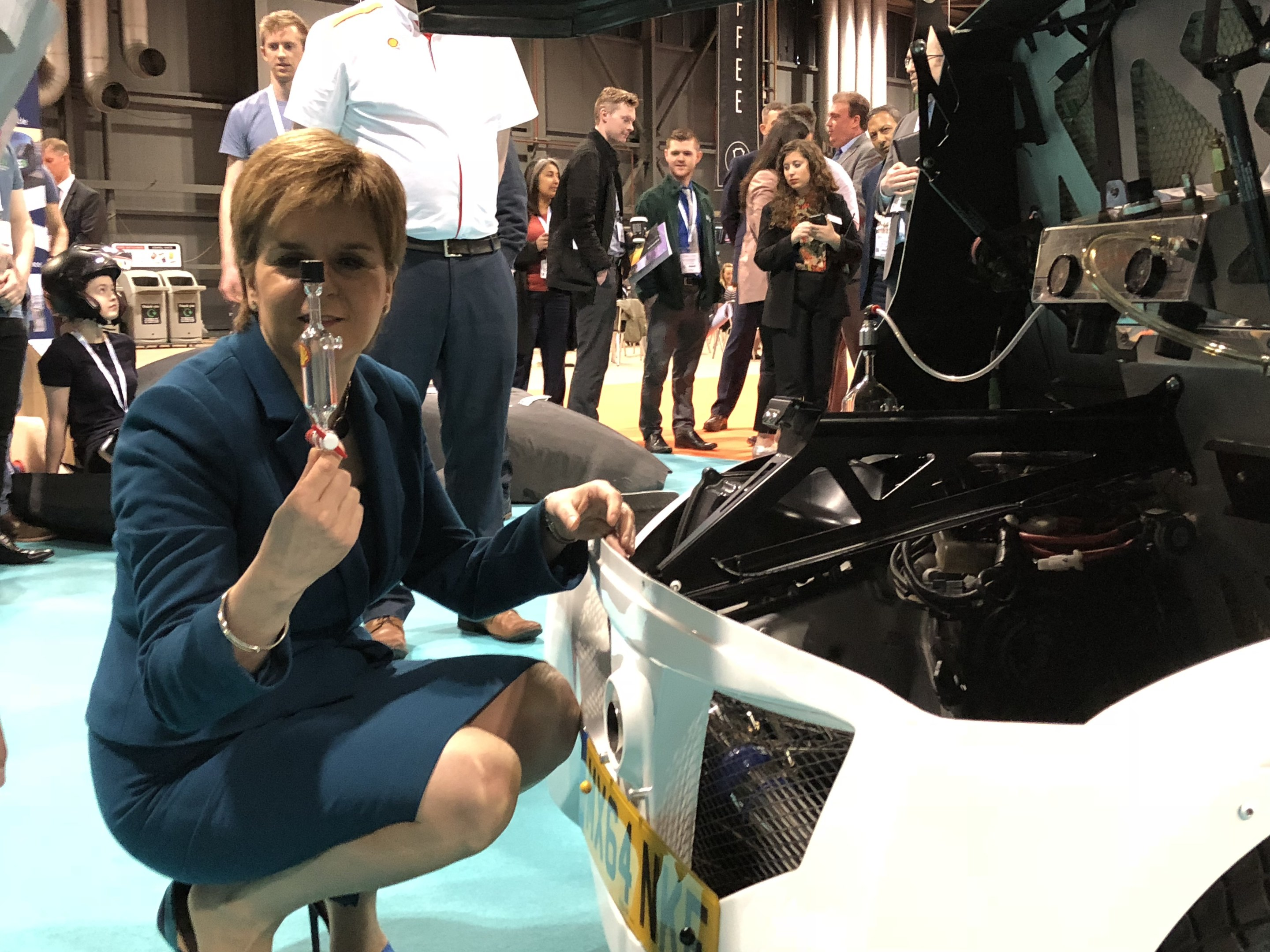 First Minister Nicola Sturgeon inspects Shell's electric vehicle.