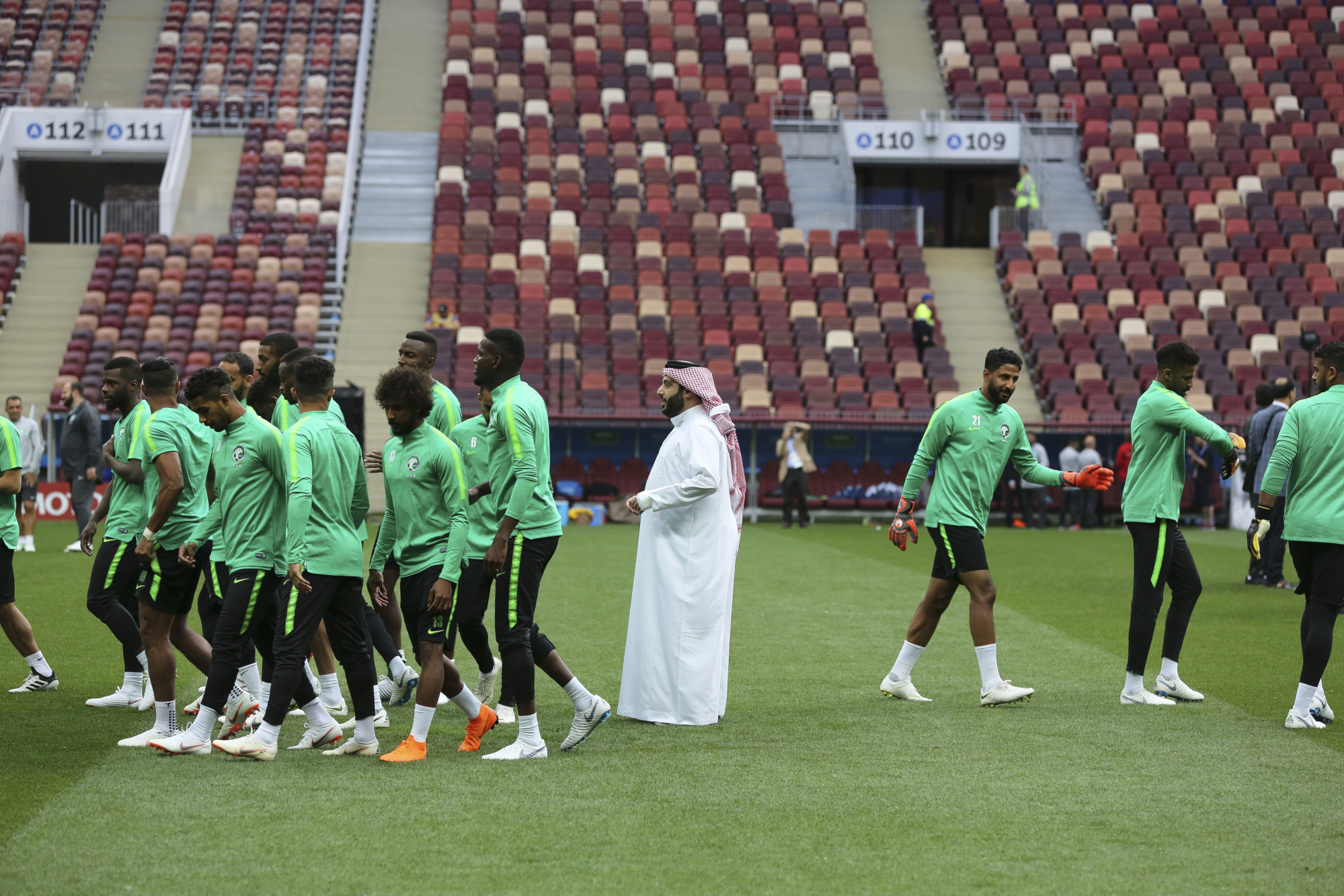 Turki Al Sheikh, Saudi Arabia's sports minister, center, joins the Saudi Arabia football team during a practice session ahead of the FIFA World Cup opening match at the Luzhniki stadium in Moscow, Russia, on Wednesday, June 13, 2018.  Photographer: Andrey Rudakov/Bloomberg
