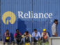 Laborers sit outside a Reliance Industries construction site at the Bandra Kurla Complex in Mumbai, India, on Sunday, Jan. 28, 2018. India's economy is expected to grow at 6.75 percent this year on the back of a recovery in second half of the year, Chief Economic Adviser Arvind Subramanian said in the Economic Survey presented in Parliament on Nov. 29. Photographer: Dhiraj Singh/Bloomberg