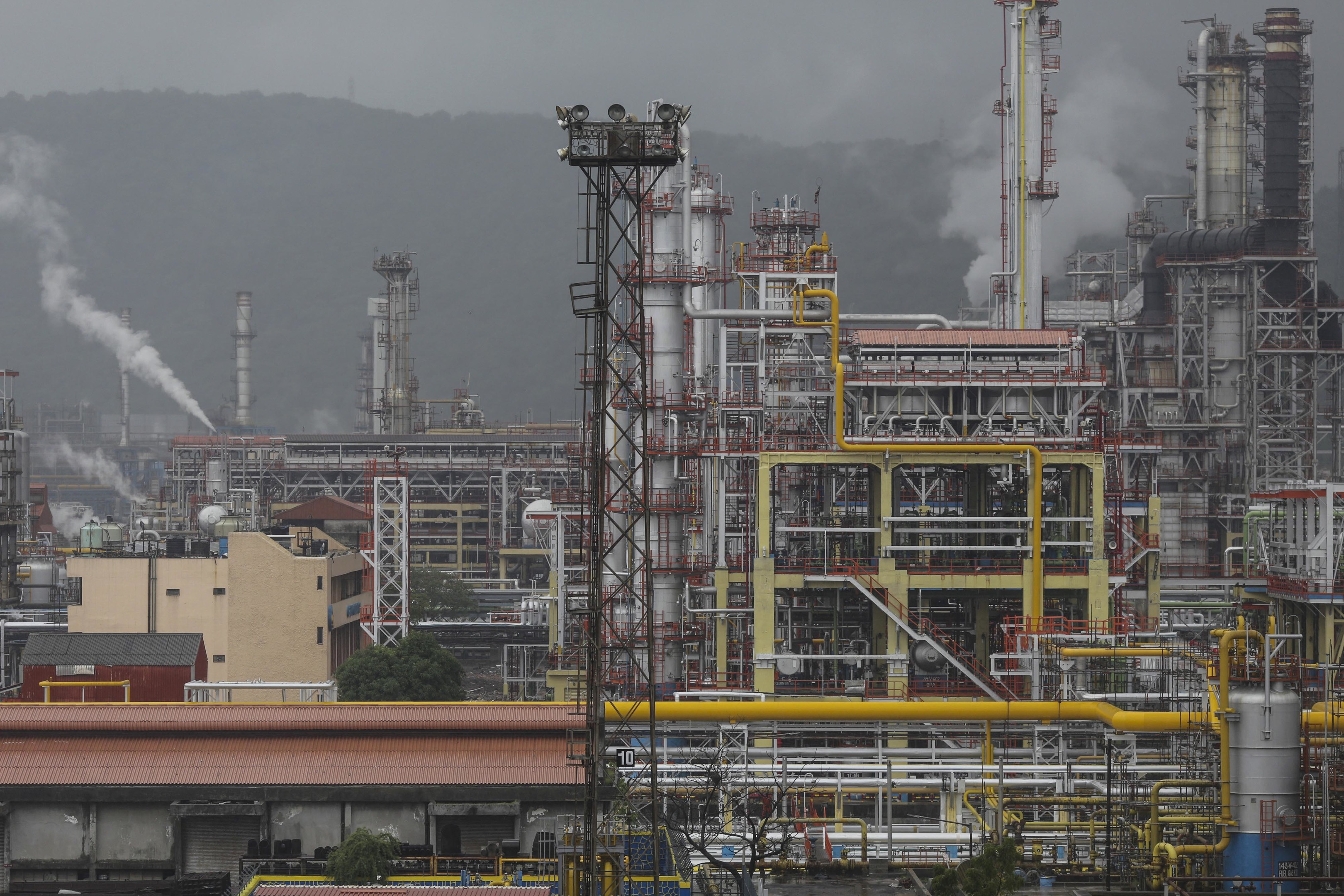 The Bharat Petroleum Corp. refinery stands in the Mahul area of Mumbai, India, on Thursday, June 28, 2018. The Indian rupee slumped to an all-time low as a resurgence in crude prices and the emerging-market selloff took a toll on the currency of the world's third-biggest oil consumer. Photographer: Dhiraj Singh/Bloomberg