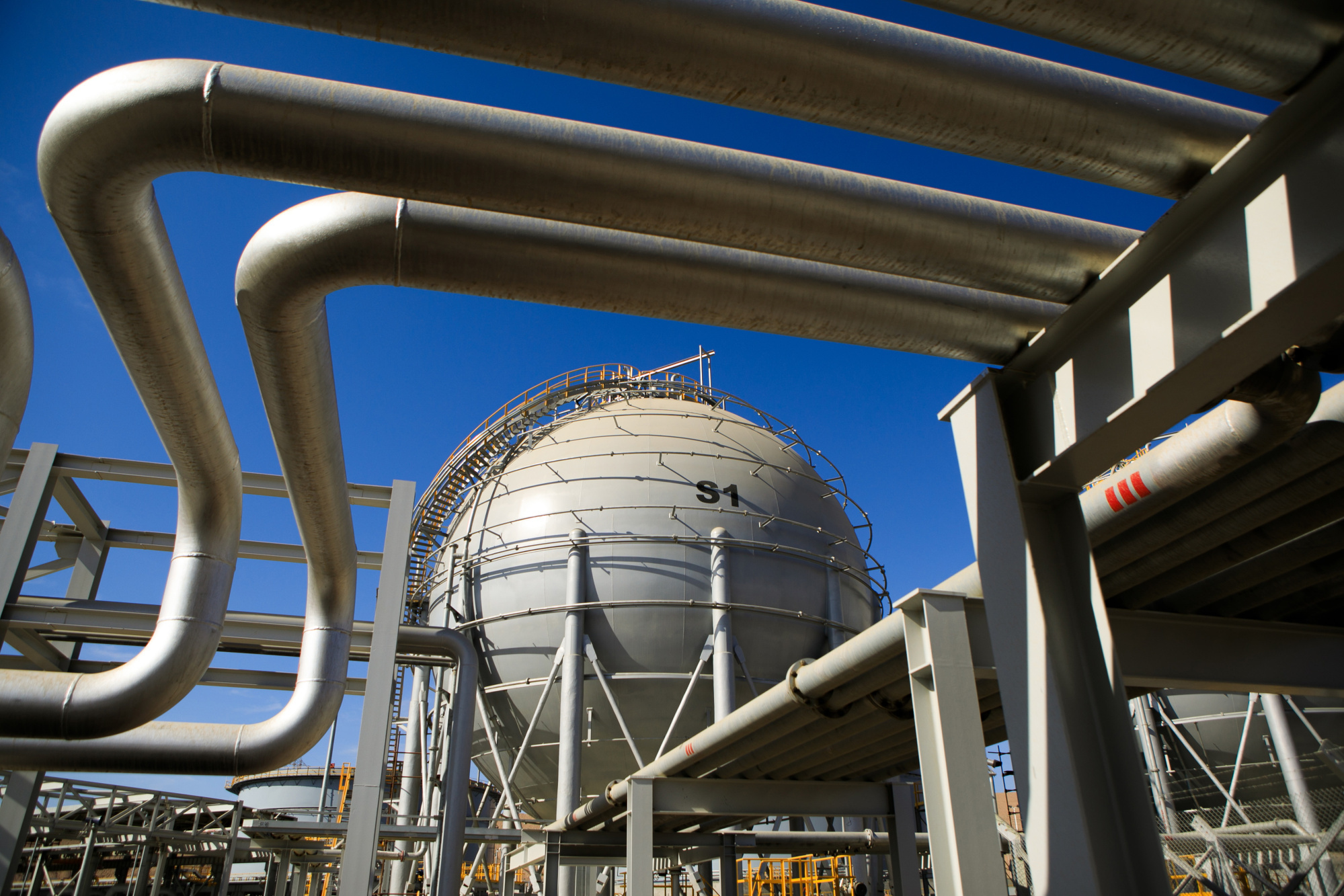 Storage sphere tanks for liquefied natural gas (LNG) sit near transfer pipes at Aqaba port, operated by Aqaba Development Corp., in Aqaba, Jordan, on Wednesday, April 11, 2018. Both the LNG and the liquefied petroleum gas (LPG) terminals were developed to secure the supply of gas resources after the disruption in Egyptian natural gas imports in 2010. Photographer: Annie Sakkab/Bloomberg