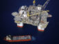 The Kobe Chouest platform supply vessel sits anchored next to the Chevron Corp. Jack/St. Malo deepwater oil platform in the Gulf of Mexico in the aerial photograph taken off the coast of Louisiana, U.S., on Friday, May 18, 2018. While U.S. shale production has been dominating markets, a quiet revolution has been taking place offshore. The combination of new technology and smarter design will end much of the overspending that's made large troves of subsea oil barely profitable to produce, industry executives say. Photographer: Luke Sharrett/Bloomberg