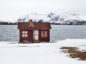 A house sits on the island of Lofoten, Norway, on Thursday, April 2, 2009.  Photographer: HEID WIDEROE/Bloomberg