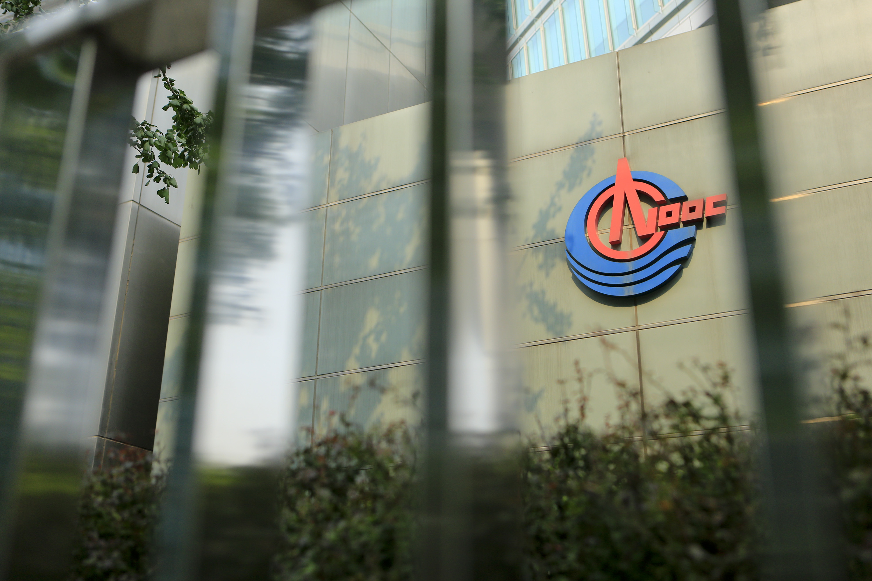 Signage for Cnooc Ltd. is displayed on the company's headquarters in Beijing, China. Photographer: Nelson Ching/Bloomberg