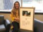 The prints have so far gone far and wide - pictured is Jill MacKey, lead safety officer from the Canada-Newfoundland and Labrador Offshore Petroleum Board who purchased a board in memory of lives lost in the Ocean Ranger disaster of 1982.