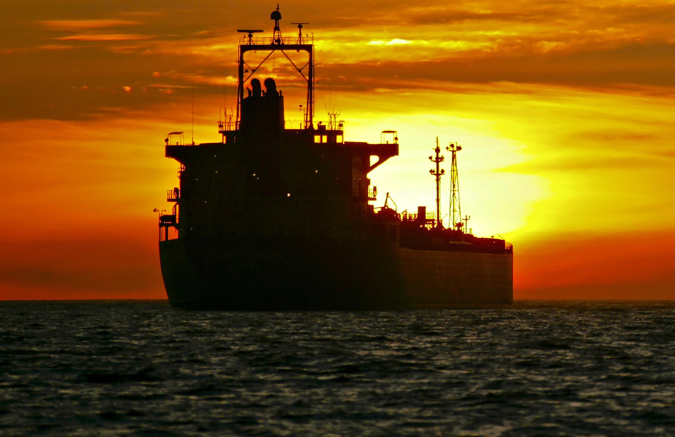 An oil tanker is anchored near the Port of Long Beach, California, U.S. Photographer: Tim Rue/Bloomberg