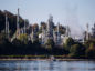 A boat sails past the Burnaby Refinery, operated by Parkland Fuel Corp., in Burnaby, British Columbia, Canada, on Wednesday, Sept. 19, 2018.