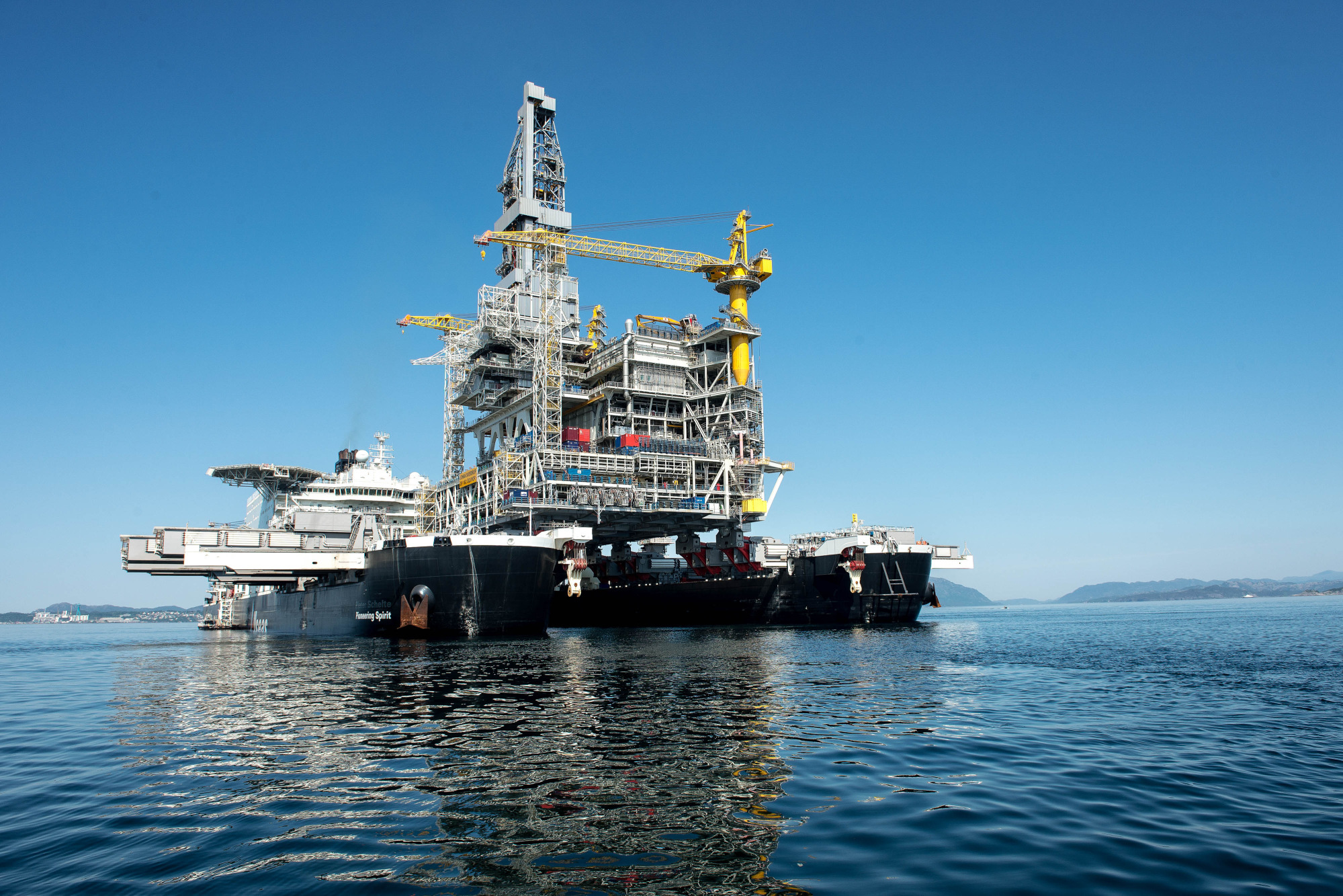 An oil drilling platform sits on board the world's largest construction vessel, the Pioneering Spirit, in the Bomla fjord near Leirvik, ahead of its transportation to the Johan Sverdrup oil field, Norway, on Friday, June 1, 2018. Equinor ASA has reduced the break-even price to below $20 a barrel in its flagship Johan Sverdrup oil project in the North Sea. Photographer: Carina Johansen/Bloomberg