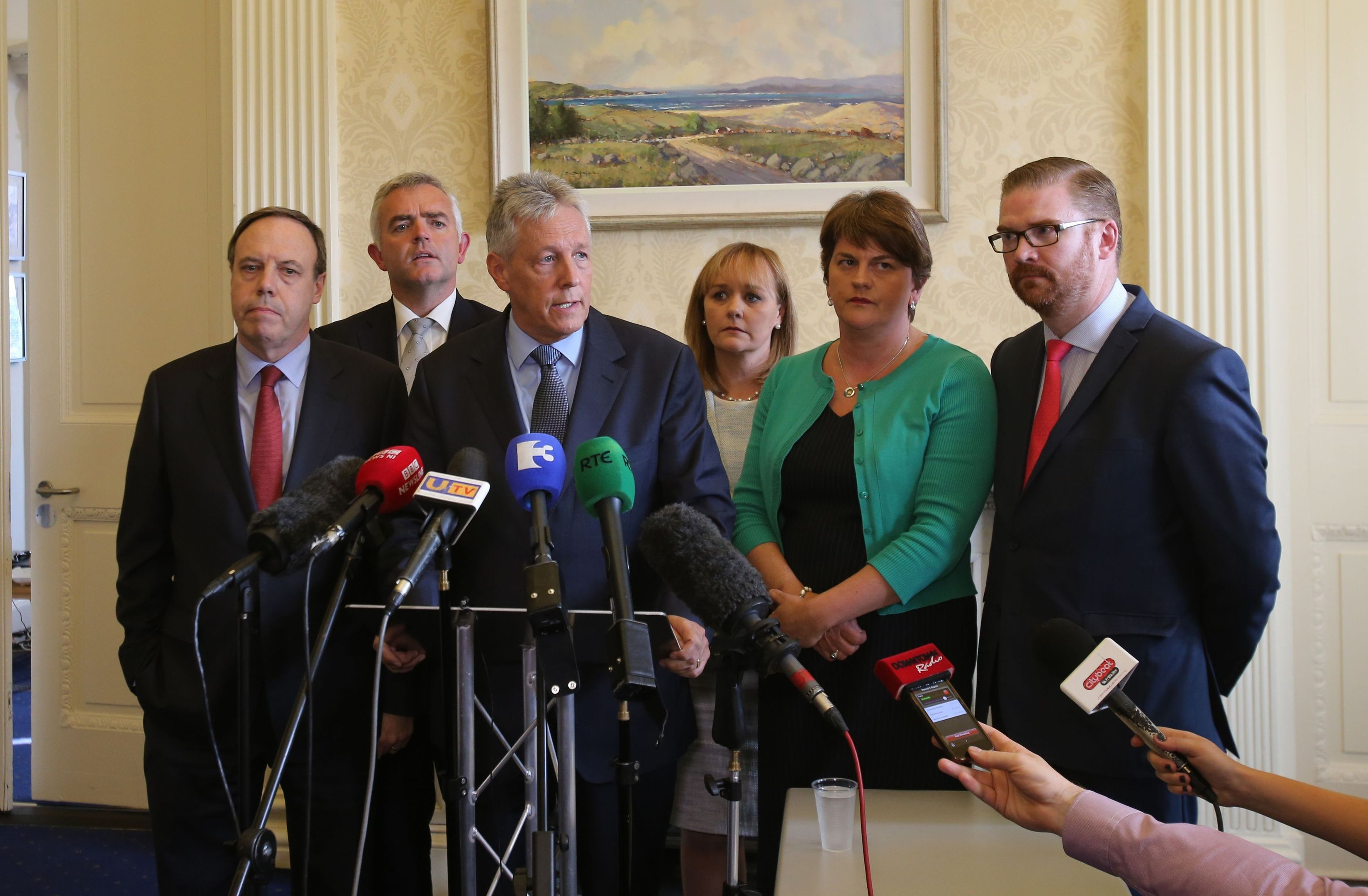 First Minister Peter Robinson at Stormont, Belfast, watched by Nigel Dodds, Johnathan Bell, Michelle Mcilveen, Arlene Foster and Simon Hamilton,  announces that he is standing aside, and the majority of his Democratic Unionist ministers are to resign, with party colleague Arlene Foster to take over as acting First Minister. PRESS ASSOCIATION Photo. Picture date: Thursday September 10, 2015. The surprise move from the DUP leader comes amid an Assembly crisis in the wake of a murder linked to the IRA murder. See PA story ULSTER Politics. Photo credit should read: Niall Carson/PA Wire