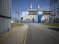 Transformer substations stand behind fences outside the coal powered power plant operated by RWE AG in Lingen, Germany. Photographer: Jasper Juinen/Bloomberg