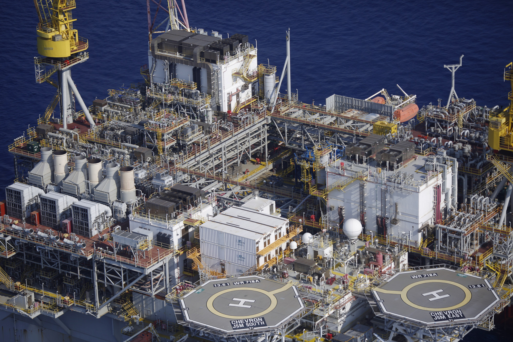 Helipads are seen aboard the Chevron Corp. Jack/St. Malo deepwater oil platform in the Gulf of Mexico off the coast of Louisiana, U.S., on Friday, May 18, 2018. While U.S. shale production has been dominating markets, a quiet revolution has been taking place offshore. The combination of new technology and smarter design will end much of the overspending that's made large troves of subsea oil barely profitable to produce, industry executives say. Photographer: Luke Sharrett/Bloomberg