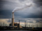 Emissions rise from the Duke Energy Corp. coal-fired Asheville Power Plant ahead of Hurricane Florence in Arden, North Carolina, U.S., on Thursday, Sept. 13, 2018. Hurricane Florence's wrath hit the North Carolina coast, but the full effects of the storm, still centered 100 miles from shore, are yet to come. Photographer: Charles Mostoller/Bloomberg