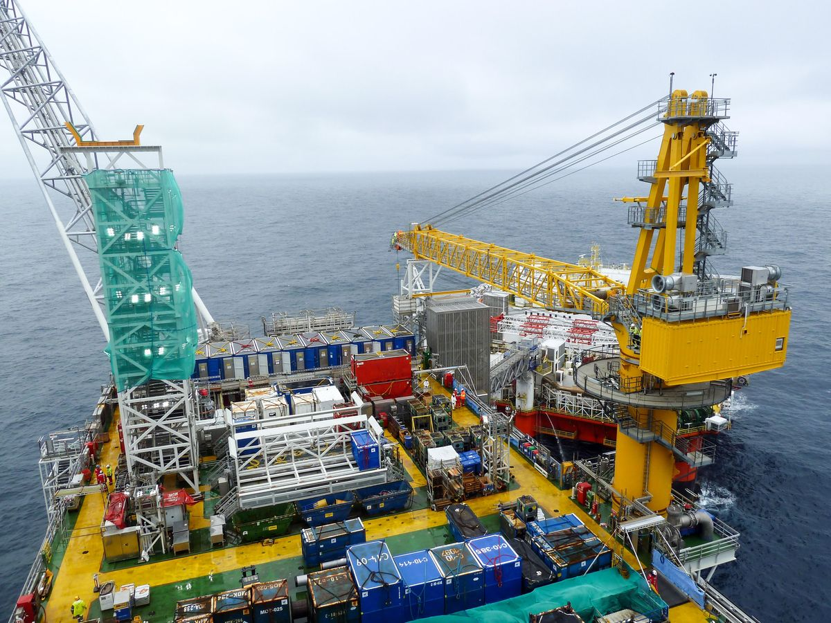 The Johan Sverdrup riser platform, operated by Equinor ASA, center, and the Safe Zephyrus mobile accommodation unit, operated by Prosafe SE, stand in the Johan Sverdrup offshore oil field, about 160 kilometers (100 miles) west of Norway's oil capital, Stavanger, Norway, on Wednesday, Aug. 22, 2018. When Sverdrup reaches maximum production of 660,000 barrels a day by the middle of the next decade, it will make up about 40 percent of the country's total oil and gas output, according to Equinor ASA. Photographer: Mikael Holter/Bloomberg