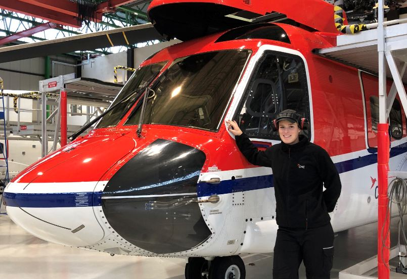 CHC Helicopter engineer Ellie Whittle services an aircraft at the company's Aberdeen operations base.